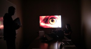 Screen-Shot, dark room and a closeup of a moving eye